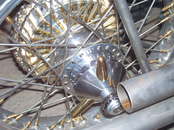 motorcycle wheel spinner with brass studs