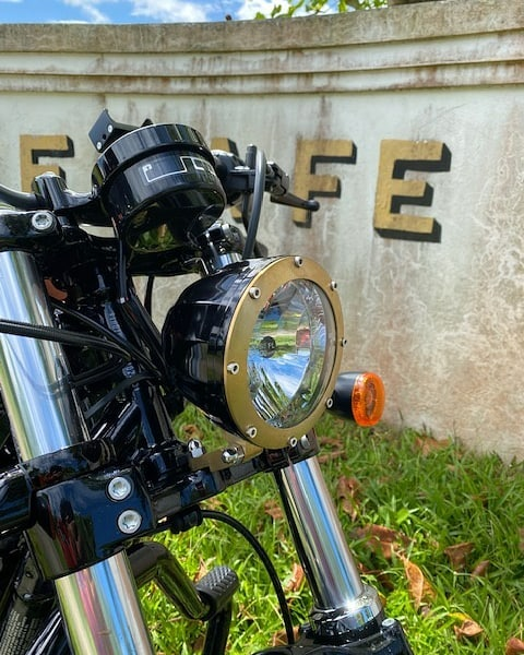 black and brass harley headlight